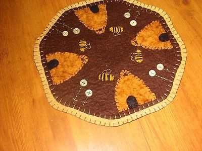 """Offered to you by: Bits of Cloth I have for you a new primitive candle mat that I have handcrafted from woolfelt. It is handsewn and hand cut with great care. Thee candle mat is 9"""" in dia. This is a d                                                                                                                                                      More"""