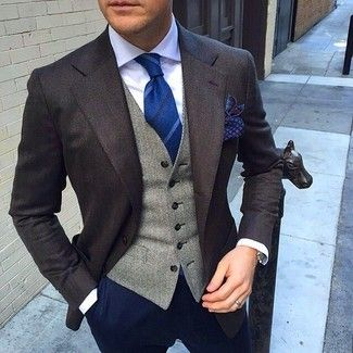 Men's White Dress Shirt, Blue Vertical Striped Tie, Navy Print Pocket Square, Grey Herringbone Waistcoat, Dark Brown Blazer, and Navy Chinos