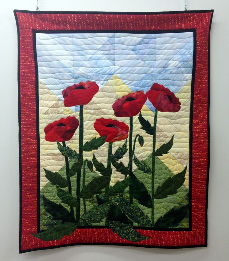 'Poppy Garden' wall hanging from 'Mighty Tree'  wall hanging from Fran Holland's Masterpieces: Pieced Landscapes of the North. March 2016, The Northern Artist Gallery.