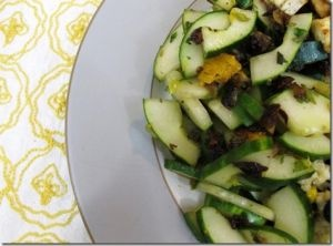Cucumber Orange and Raisin Salad... raisins are minced before added to the dressing to really add a ton of flavor!