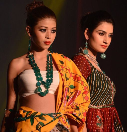 Gems and #precious metals gleamed under the arc lights as the #models glided down wearing stunning #diamond, polki and precious gemstone sets b...