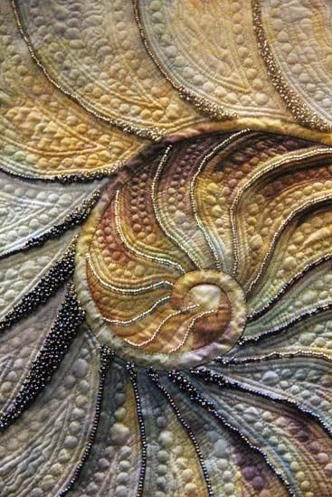Fabric art... Seashore quilt square features a shell pattern embellished with trapunto and embroidery beading.
