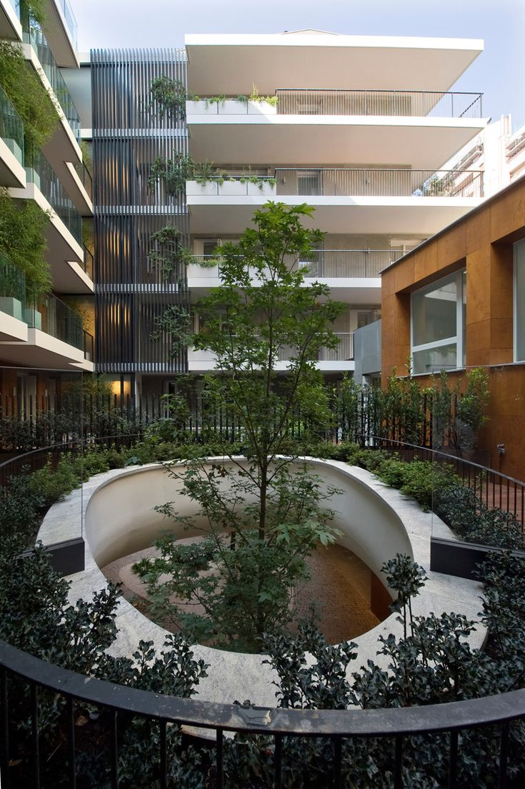 """Trees grow through two """"elliptical eyes"""" of a suspended garden at this building"""