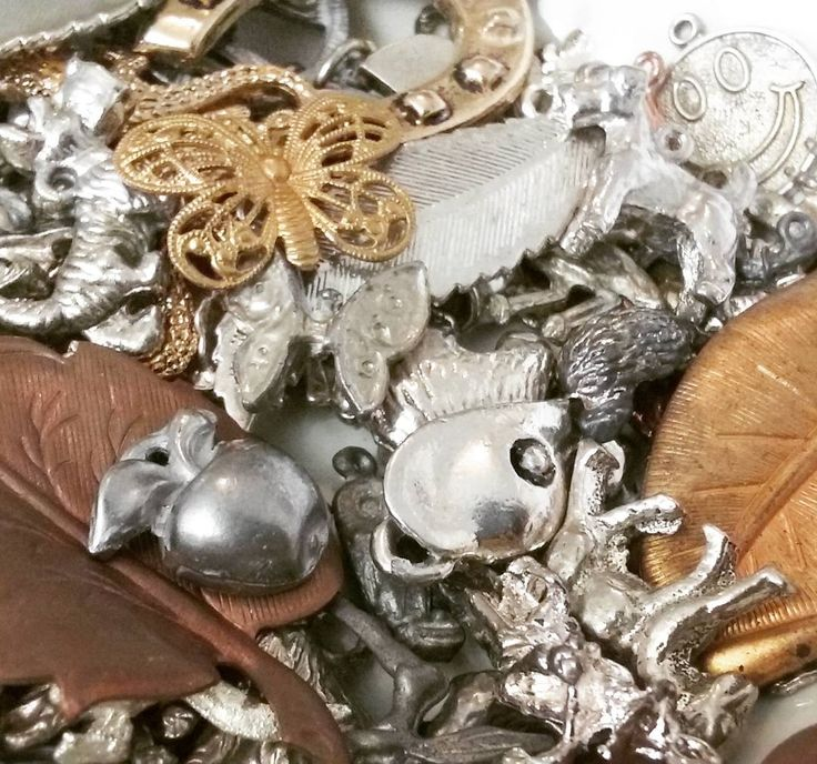 The joys of a good stock clearance: discovering a goldmine of loose metal charms you've never seen before hiding in the back corner.  www.CosBits.com #Cosbits #haberdashery #metal #metalcharms #vintagejewelry #vintagecharms #shiny #jewelry #charms #noveltycharms #Adelaide #notions #adelaidecraft