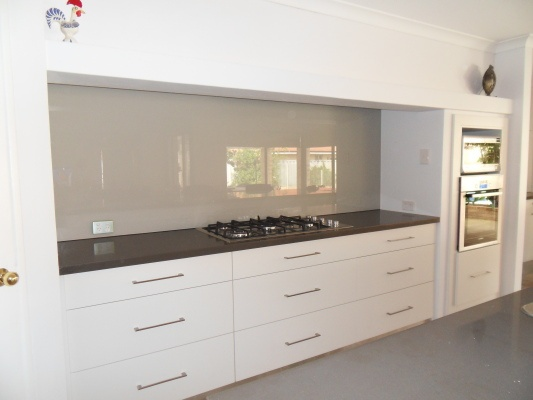 Love this splashback colour with the white benches and dark bench top,