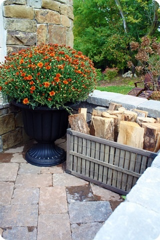 Use a crate to store fire pit wood on patio.