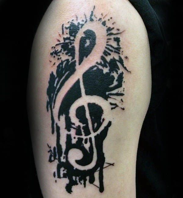 Upper Arm Male Tattoo Of Treble Clef With Black Ink Paint Splatter Design