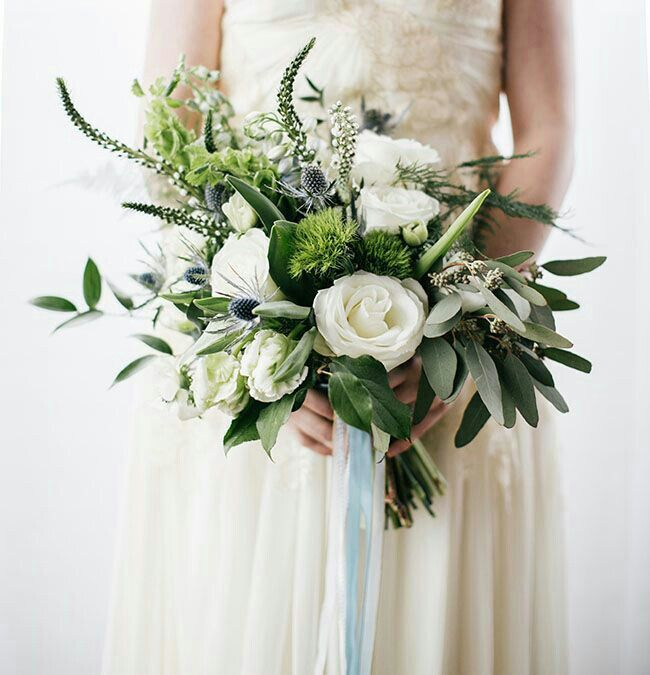 """Free Form"" Bridal Bouquet: Blue Eryngium Thistle, White Veronica, Green Bells Of Ireland, White Garden Roses, Green Parrot Tulips, Green Trick Dianthus, Green Ruscus, Green Seeded Eucalyptus, & Green Tree Fern, Hand Tied With Light Blue & White/Ivory Ribbons~~~~"