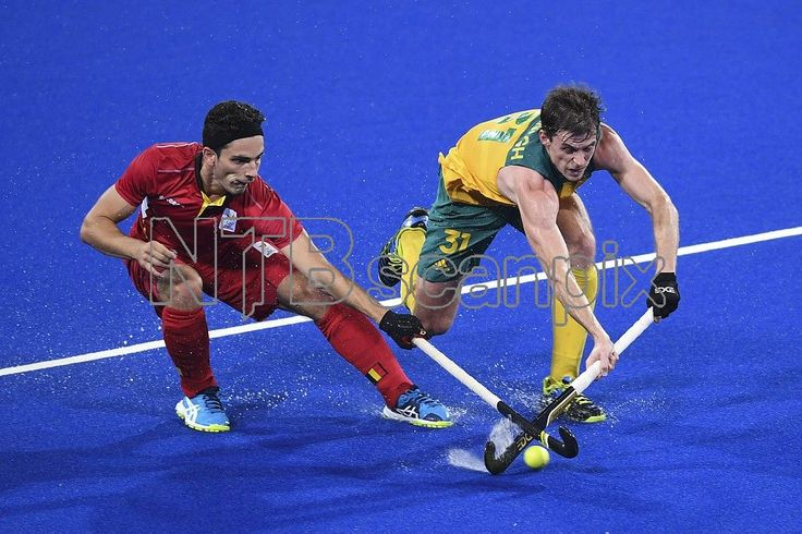 Fergus Kavanagh of Australia (R) fights for the ball with Tanguy Cosyns of Belgium (L) during the men's Field Hockey group A match between Belgium and Australia of the Rio 2016 Olympic Games at the Olympic Hockey Centre in Rio de Janeiro, Brazil, 09 August 2016. EPA/LUKAS COCH AUSTRALIA AND NEW ZEALAND OUT
