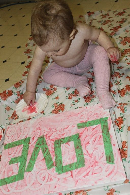 Tape word on canvas - finger paint - remove tape. Would be cute to do with baby's name for their room.