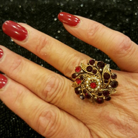 FLORENZA  COCKTAIL RING Statement ring, adjustable in size, circa 60's. French gold filagree red topez rhinestone marked FLORENZA. Gorgeous vintage asjustable French filagree gold tone and faux pearls. Setting pictured in  a .50 inch raised detail crown filagree mount, 1 inch jeweled floral petal pattern. Detailed all the way around with a detailed floral petal pattern. Truly stunnng!! All stones intact, perfect condition. florenza Jewelry Rings
