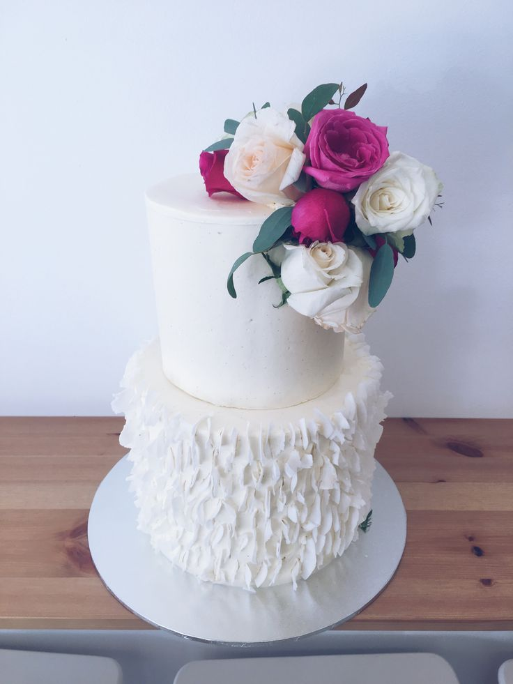 2 tier white buttercream wedding cake with coconut flake bottom & toned pink roses & blue gum #haranspatisserie