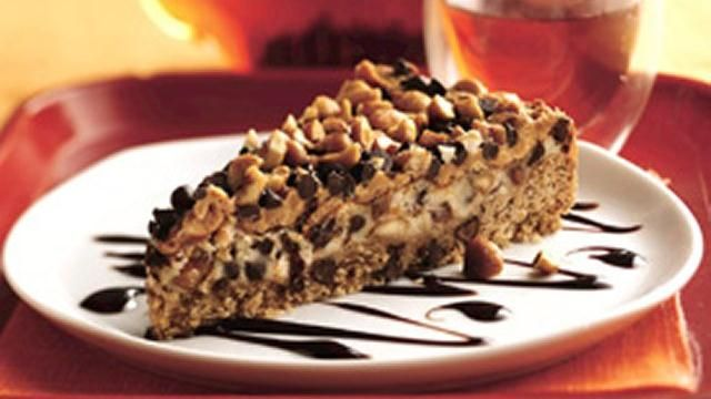 Refrigerated cookie dough forms the tender crust of this rich dessert topped with crunchy honey-roasted peanuts.