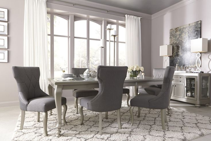 Coralayne 7-Piece Rectangular Extension Dining Set in Silver.  This is from Ashley Furniture.  I'd like to see it in person to see if it looks cheap or cheesy.  Have found it as low as $479 on-line.
