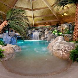Indoor tropical lagoon with beach entry