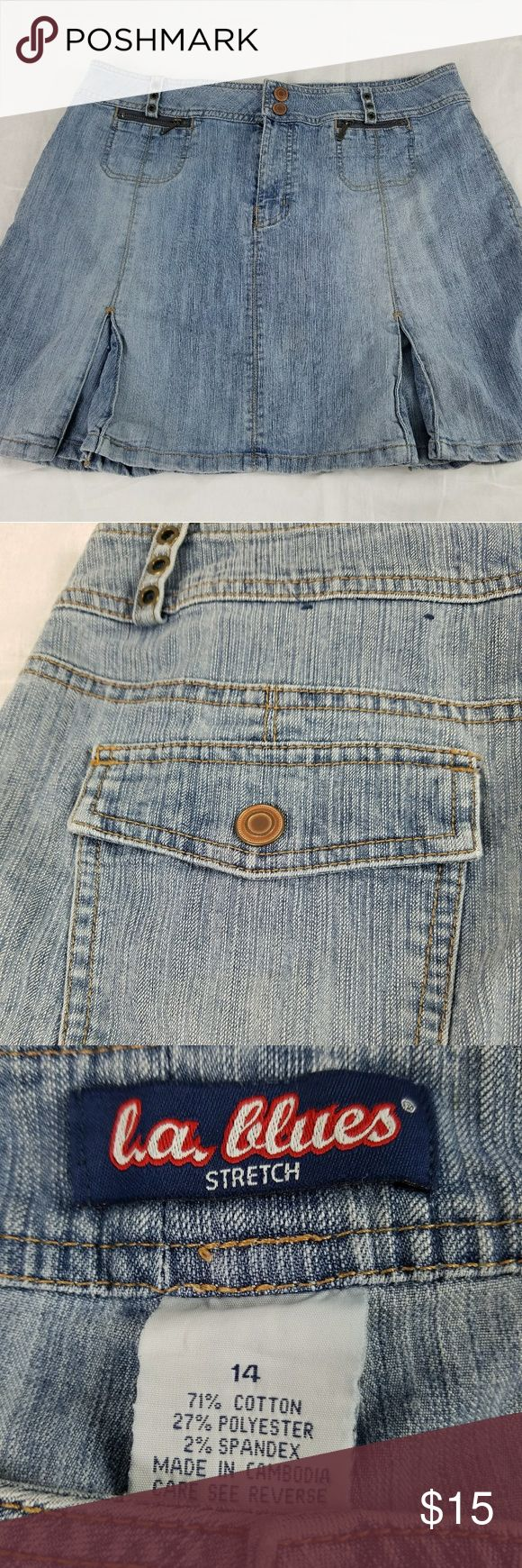 """LA Blues Stretch Denim Skirt LA Blues Stretch light denim skirt. Size 14, pockets galore! Small pleats on the bottom front and back. Rivets on the belt loops. No flaws that I can find.   32"""" waist  30"""" in length   From a clean smoke free home. LA Blues Skirts"""
