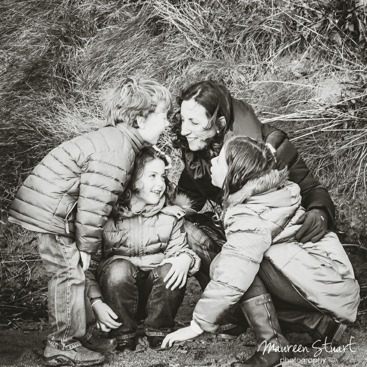 In family portraits I love images where the family are engaging with each other.  Depending on the age of the children, giving them a challenge, as I did with this family to get them all interacting and to make them forget I am there, can work well.  The triangular pose which resulted adds to this happy portrait of this mum with her children. www.maureenstuartphotography.com