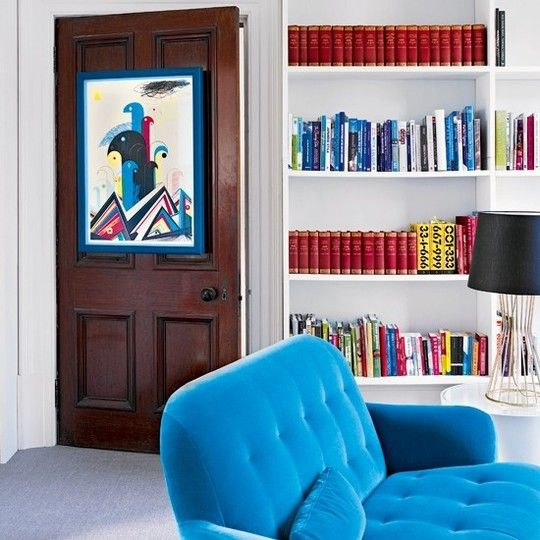 Hang art on a door and keep both the hallway and the room from feeling gloomy!: Wall Art, The Doors, Wall Spaces, Hanging Art, Apartment Therapy, Living Room, Blue Chairs, Frames Art, White Wall
