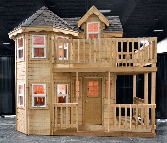 The Princess is a traditional style play house, with open rooms inside and a large front porch outside