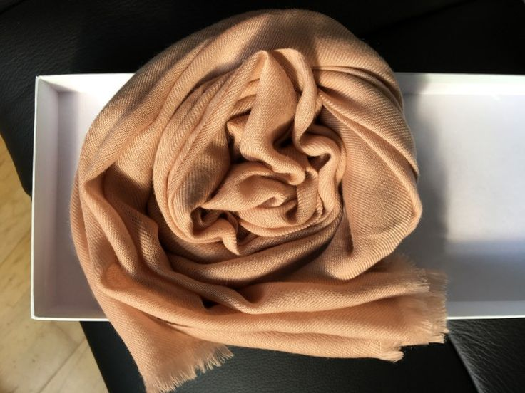 A taupe colour coiled pure cashmere Cressida scarf by the iconic British brand Cornelia James