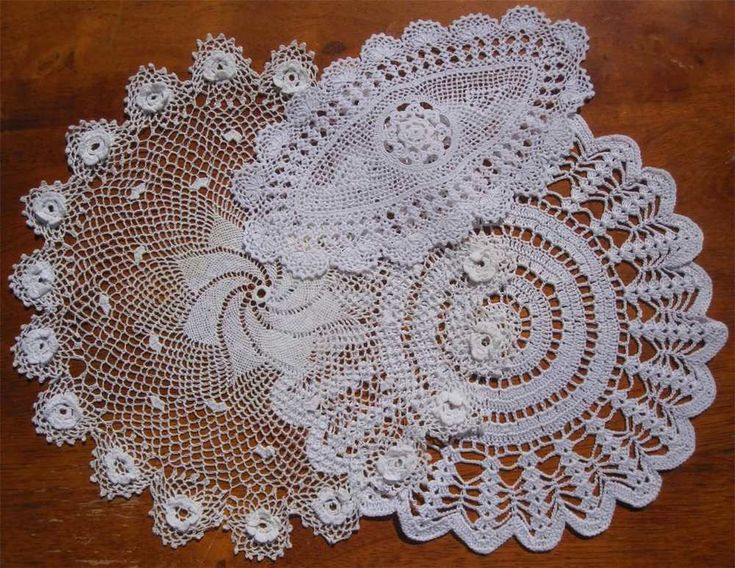 Three Vintage Hand Crochet DOILIES 27cms Diameter 24cms Diameter 21cms x 12cms Crocheted in White Cotton In Very Good condition as photos show. *Laundered *Starched *Ironed