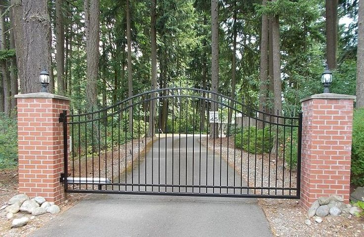 Single swing gate with posts wrapped in brick masonry