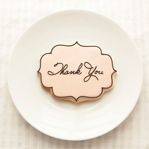 Show your special guests in with style and grace with place cards that are actually melt-in-your-mouth butter cookies made to resemble letter-pressed cards.