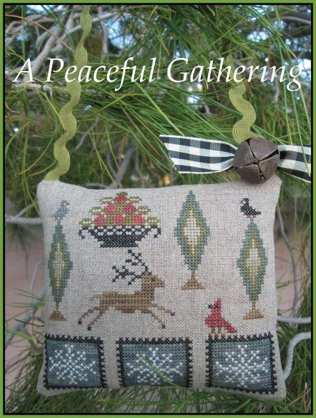 A Peaceful Gathering is the title of this cross stitch pattern from The Scarlett House that is stitched with Gentle Art Sampler threads (Country Redwood, Oatmeal, Black Licorice, Chamomile, Tin Bucket, Picnic Basket, Deep Forest, Piney Woods).