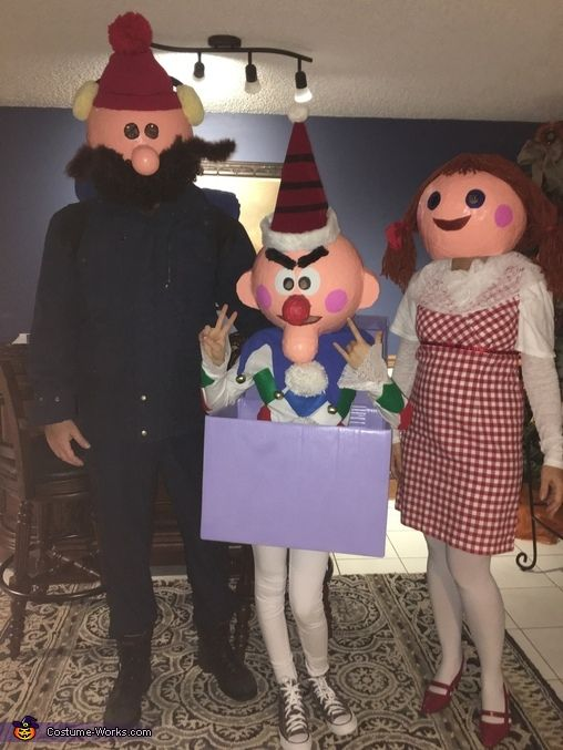 Monique: This is my daughter Gabby dressed as Charlie in the box. This is my husband Ed addressed as Cornelius. I am the doll. All these characters are from Rudolph the...