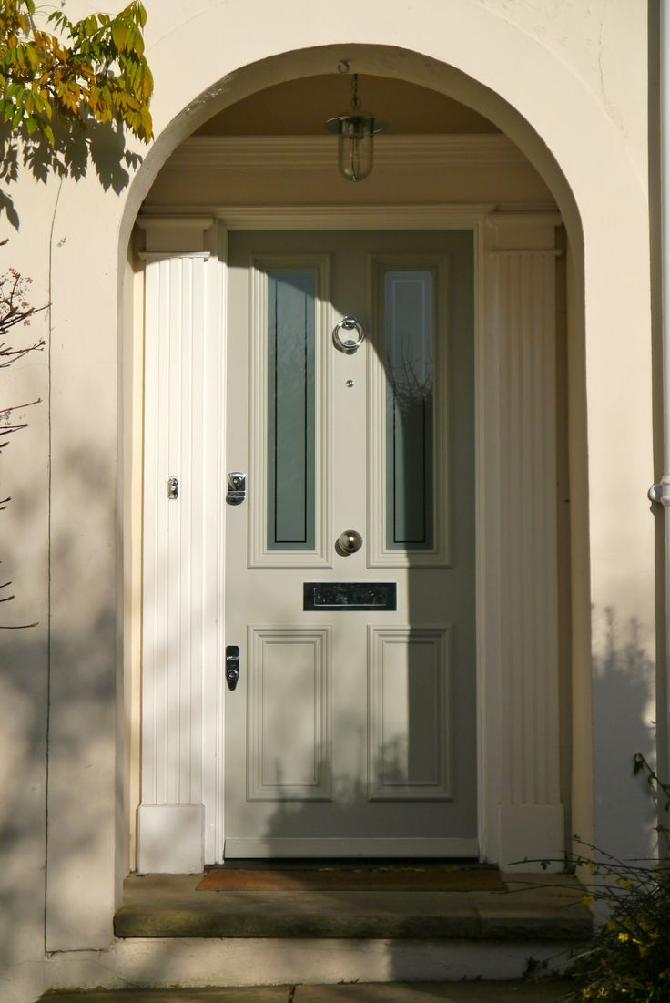 Front door painted in Farrow and Ball LAmp Room Gray...nore details on Modern Country Style blog: Colour Study: Farrow and Ball Lamp Room Gray