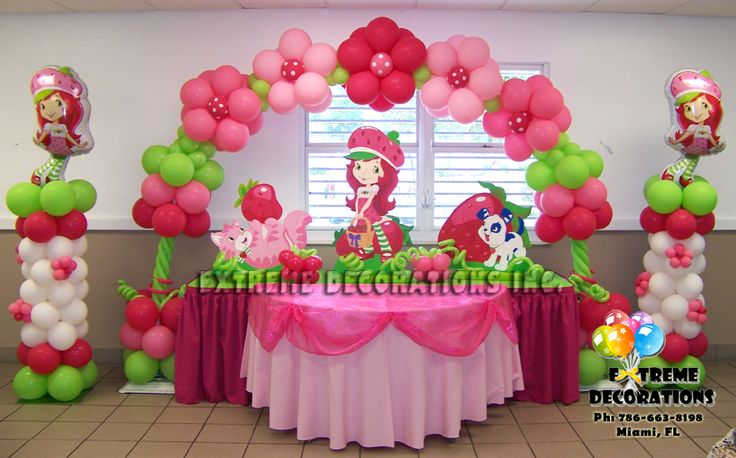 Party Decorations Miami | Balloon Sculptures - Strawberry Shortcake cake table decorations, with beautiful flower balloon arch and themed balloon columns