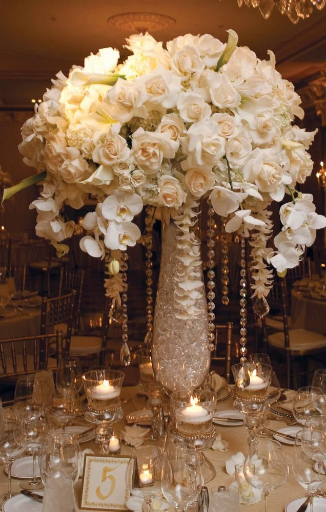 I love lush and tall table decor like this, Imported Roses, Calla Lilies, Dendrobium Blooms, White Phalaenopsis Orchids - Bell Vase with Hanging Crystals | Karen Tran Florals