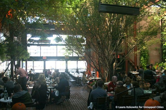 The Park, a former 10,000-square-foot taxi garage is known for its lush atmosphere and innovative food fare