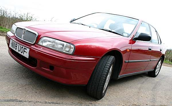 Rover 600 in the same 'nightfire red' as the colour was called, nice size engine and a 'stately' feel also N reg - shame that history was repeated just like my dad's 1100.