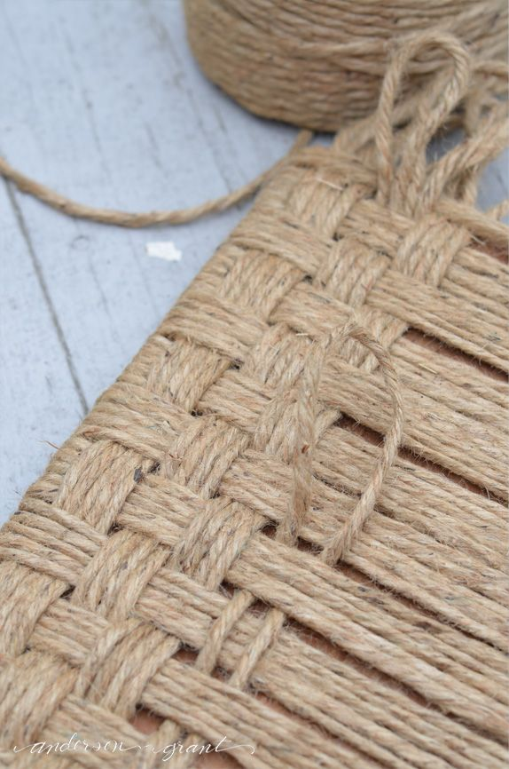Have an old wood footstool that needs a little updating? Check out this post that shows how to weave jute twine to create an upholstered stool.