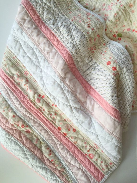 This modern baby girl quilt would be a great addition to any boho or shabby chic baby nursery! Lovely shades of pink, cream, and peach flow