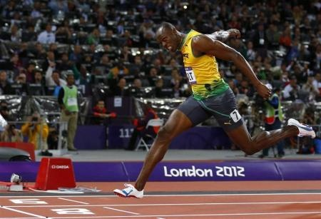 "Jamaica""s Usain Bolt crosses the finish line first to win the men""s 100m final during the London 2012 Olympic Games at the Olympic Stadium August 5, 2012. Bolt set an Olympic record with a time of 9.63 seconds."