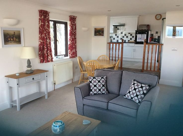 in Cornwall, GB. Atlantic Breeze is one bedroom holiday home in Carbis Bay. Suitable for a couple or single person, with a small garden, sea views and parking space. There are two steps separating the living/dining area with the open plan kitchen. Bars, restaurant...