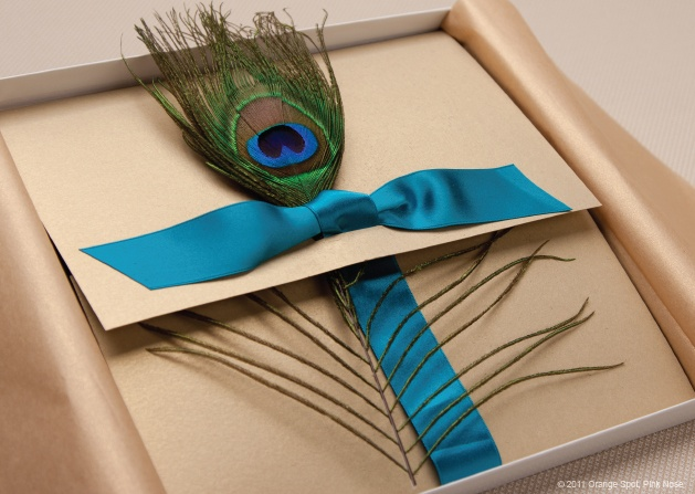 Love the rich peacock feather against the neutral invitation