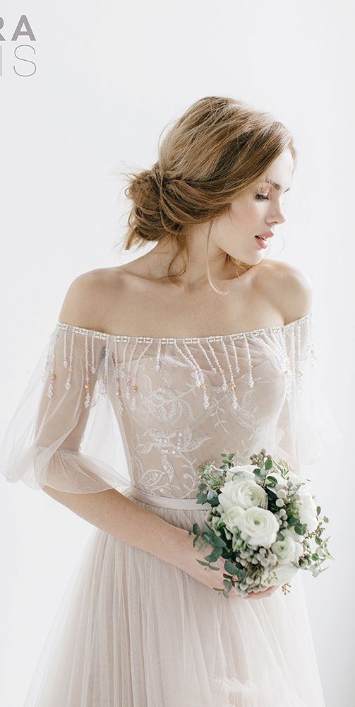 Thanks to my pear shape, I am aaaallllll about the off-the-shoulder styles!  These tulle puff sleeves and the beaded fringe are all the drama a girl could ask for.