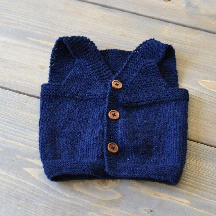 Knitted babys vest.