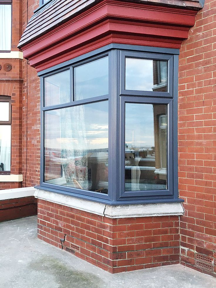 Full house of Rehau UPVC Anthracite Grey windows, a Modern contemporary Design, with Top and Side Openings. Complete with a Red Composite door, with the Altmore Design and Zinc Prairie Glass Panels, with Matching Half Anthracite UPVC Panel, half Glass Sides, and Divided top Lights.