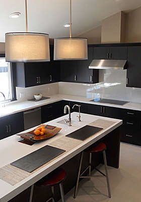 white countertops and dark cabinets