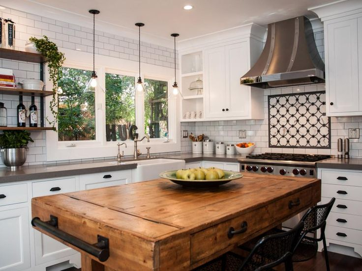 "When updating a historic home in the Hancock Park area of Los Angeles, Sabine Klingler Kane designed the kitchen around her clients' butcher-block island. ""My client had the island long before we started the remodel,"" she says. ""It looks perfectly vintage, but it is actually a reproduction made from reclaimed wood. It is ideal for their young daughter as she does not need to be careful with her crayons and spilling food. It has drawers on both sides, and wine storage underneath as well as…"