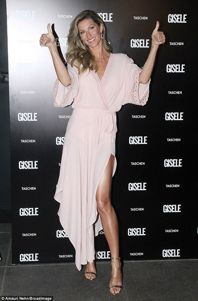 So happy: Gisele Bundchen, in Brazil this weekend to promote her coffee table book Gisele,...