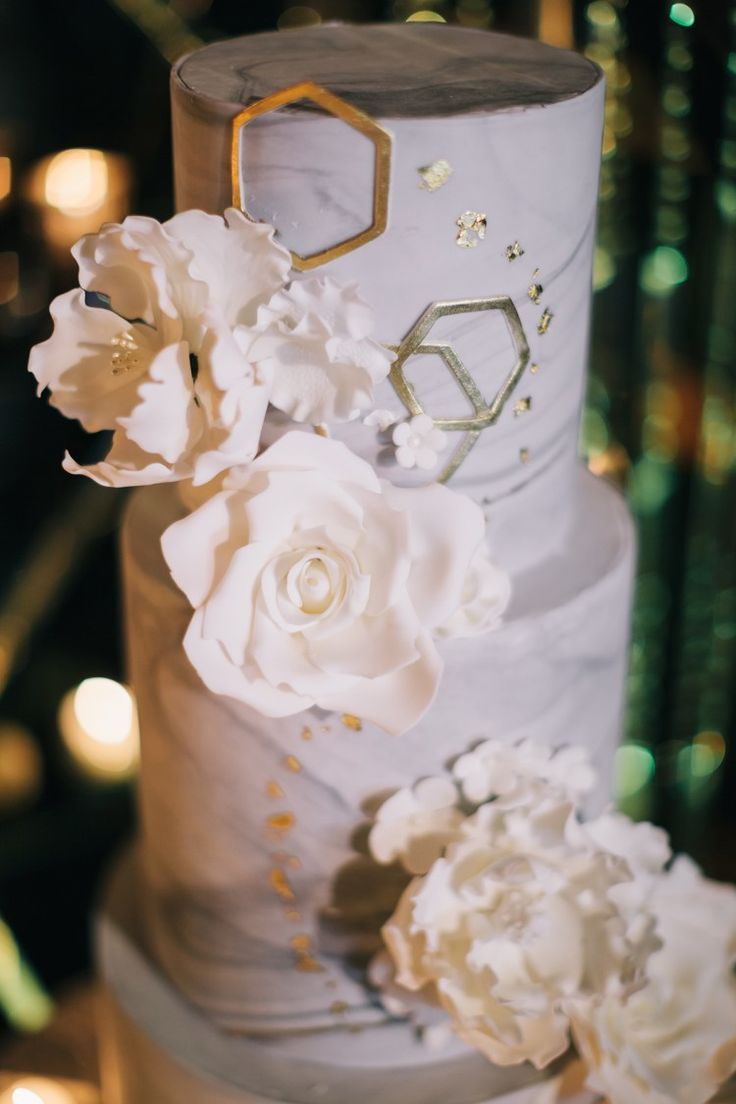 Glam Wedding Inspo – an Aisle Society Experience presented by Minted  Beautiful, unique white and gold wedding cake.   Photography: Erika Layne Photography