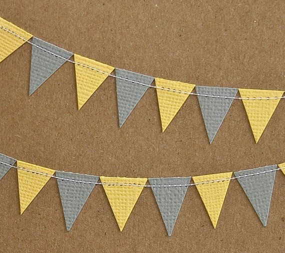 Bunting but in yellow and white and with writing on it