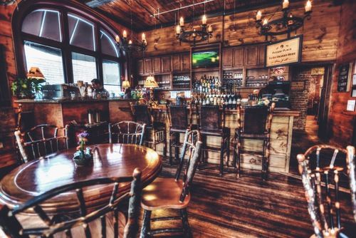 """Coffee shop gem in Bryson City North Carolina: it's a """"Mountain Social House"""" and it feels as if you have stepped into a mountain resort! It's a solid experience and a perfect stop as you explore downtown.  Cork & Bean. Coffee, travel, North Carolina"""