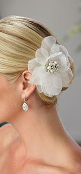 Discover hundreds of elegant designer wedding dresses created by David Tutera, Sophia Tolli, James Clifford & more. Find your perfect gown today!