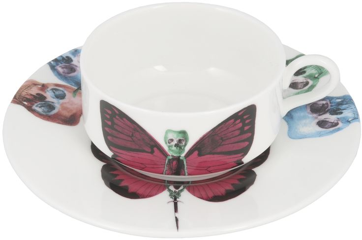 'Vix' Mocha Cup & Saucer taken from the 'Lepidoptera' range designed by Maxim from The Prodigy. Based on imagery drawn from his wonderful paintings, this range features an array of unusual creatures. Butterfly design on cup continues onto saucer. Saucer also features edgy skulls taken from each six designs. Rear of mocha cup features a 22kt gold butterfly detail. Fine Bone China. Made in Stoke-on-Trent, England.